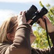 Stock Photo: Female with binoculars.