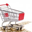 Shopping cart and coins - Stock Photo