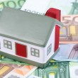 Toy house for euro banknotes as a background — Stock Photo #10806144