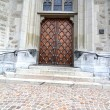 Massive wooden door in church — Photo