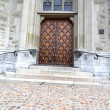 Massive wooden door in church - Stock Photo