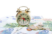 Alarm clock for euro banknotes isolated on white background — Stock Photo