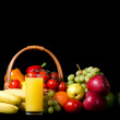 Fresh vegetables and fruit on a black background - Stock Photo