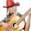 The beautiful girl in a cowboy's hat isolated — 图库照片