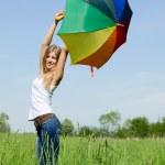 bella ragazza con un ombrello multicolore — Foto Stock