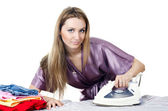 The woman the housewife irons linen — Stock Photo