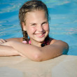 The young girl in pool — Stock Photo #11266233
