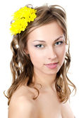 The girl with beautiful hair with yellow chrysanthemum — Stock Photo