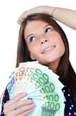 The beautiful girl with euro banknotes — Stock Photo