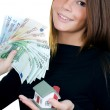 The business woman with the toy house and banknotes — Stock Photo