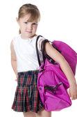 La petite fille avec un sac lila isolé — Photo
