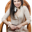 The beautiful girl in wicker chair — Stock Photo #11491041