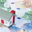 Toy house for euro banknotes as a background — Stock Photo