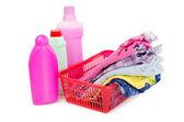 Högen av rena kläder med olika tvättmedel — Stockfoto
