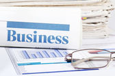 Business the newspaper with chart — Stock Photo