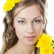 Stock Photo: Girl with beautiful hair with yellow chrysanthemum
