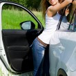 The beautiful girl stands near to white car — Stockfoto #11876563