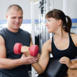 The woman with the trainer in sports club - Stock Photo