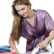 Womhousewife irons linen — Stock Photo #12186095