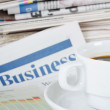 Coffee and the fresh newspaper - morning of the businessman - Stock Photo