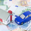 Toy house and the car for euro banknotes — Stock Photo