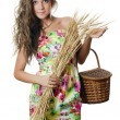 The beautiful girl with wheat ears — Stock Photo
