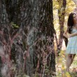 Stock Photo: Beautiful girl stands tree