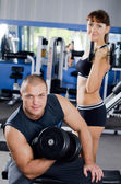 The woman with the trainer in sports club — Stock Photo