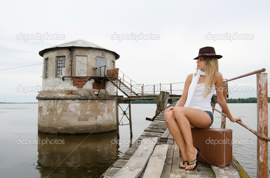 Woman with a suitcase at a pier — Stock Photo #12185996