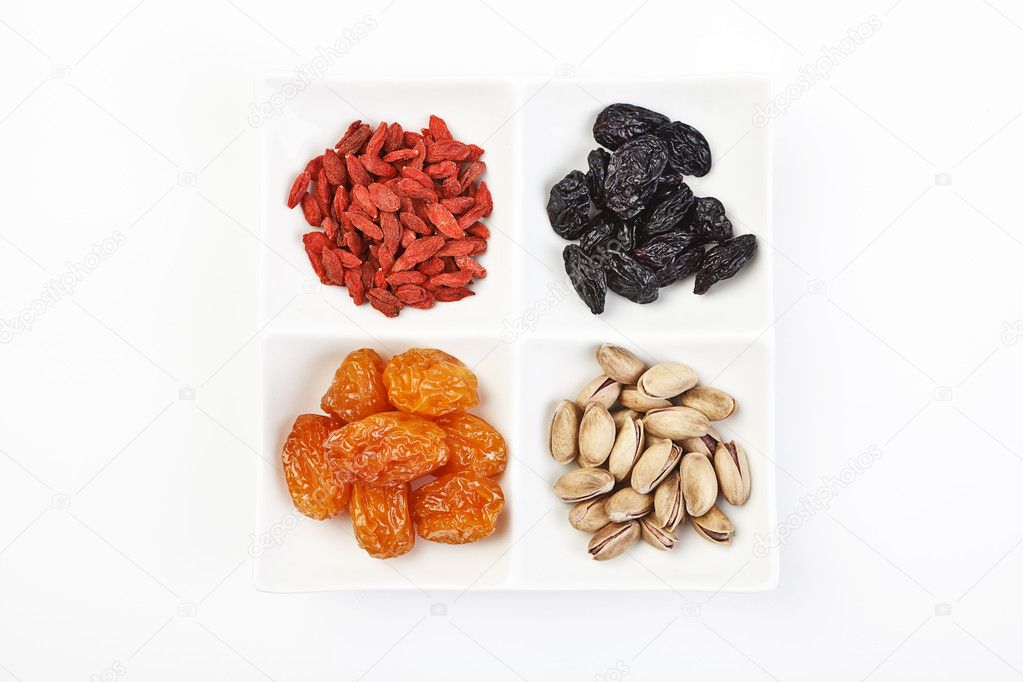 Mixed dry fruits on white. — Stock Photo #12401020
