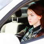 Girl in car — Stock Photo
