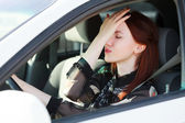 Troubles on the road, Girl hides face in hands while in a car — Stock Photo
