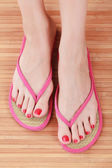 Female feet with flip-flops — Stock Photo