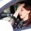 Woman with headache in a car — Stock Photo #11890561