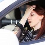 Woman with headache in a car — Stock Photo