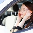 Woman with headache in a car — Stock Photo #11890566