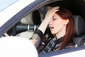 Woman with headache in a car — Stock Photo