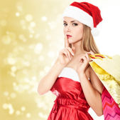 Female Santa with shopping bags — Stock Photo