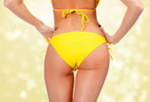 Sexy backside in yellow swimwear — Stock Photo