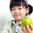 Child with green apple — Stock Photo #11443944