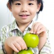 Child with green apple — Stock Photo