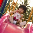 Royalty-Free Stock Photo: Child on a slide in playground