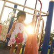 Child on a slide in playground — Stock Photo