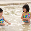 Children enjoy waves on beach — Stock Photo