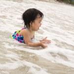 Child enjoy waves on beach — Stock Photo