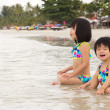 Children enjoy waves on beach — Stock Photo #12087224