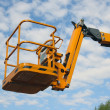 Yellow cradle of the hydraulic lift — Stock Photo