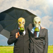 Two men in gas-mask on meadow. Conceptual composition — Stok fotoğraf