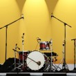 Royalty-Free Stock Photo: Drums on a yellow background