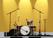 Drums on a yellow background — Stock Photo